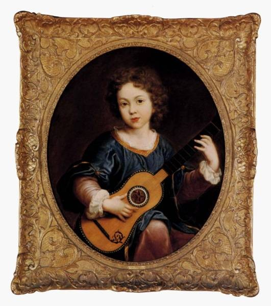 A Young Girl Playing A Guitar